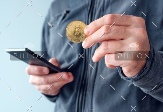 demo-attachment-11-man-with-bitcoin-and-mobile-phone-P8NS7Y4